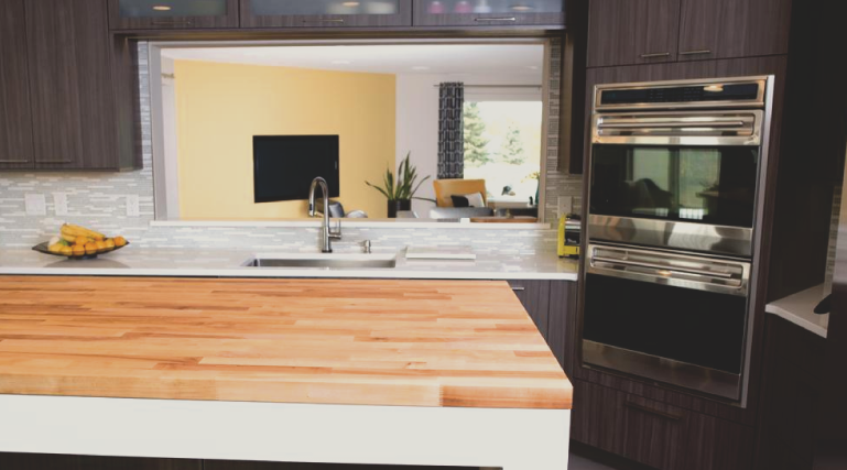 Butcher block countertops are less expensive than stone and the wood countertops are much easier to install. Butcher block counters look great!